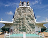 A recreational climbing wall located on the aft side of the main smokestack on board a cruise ship.