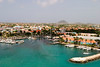 A view of the main harbor on Aruba looking inland. This photo, from a cruise ship, looks down over the city and boats.