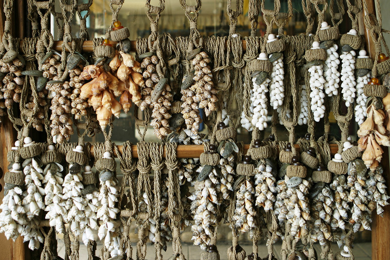 A market display of knotted ropes with tropical beach shells. This vendor in Mexico was showing these trinkets to tourists or other native visitors to the market area.