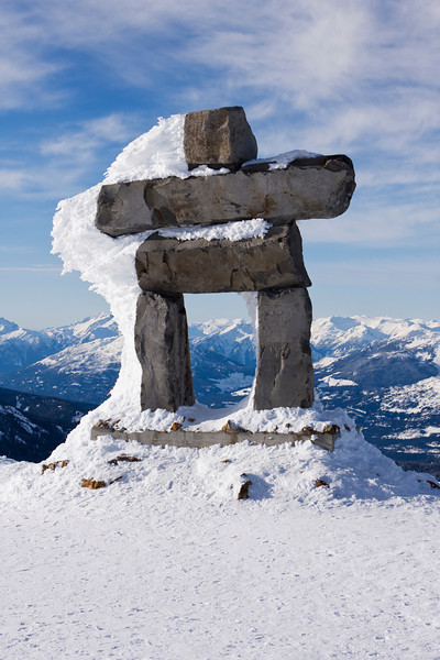 """A stone figure, resembling a person, standing near the top of Whistler Mountain. An inunnguaq, or inukshuk, is an iconic Canadian symbol. The word inuksuk means """"something which acts for or performs the function of a person."""" The word comes from the morphemes inuk (""""person"""") and -suk (""""ersatz or substitute""""). It is pronounced inutsuk in Nunavik and the southern part of Baffin Island. In many of the central Nunavut dialects, it has the etymologically related name inuksugaq. It is a symbol of the 2010 Winter Games."""
