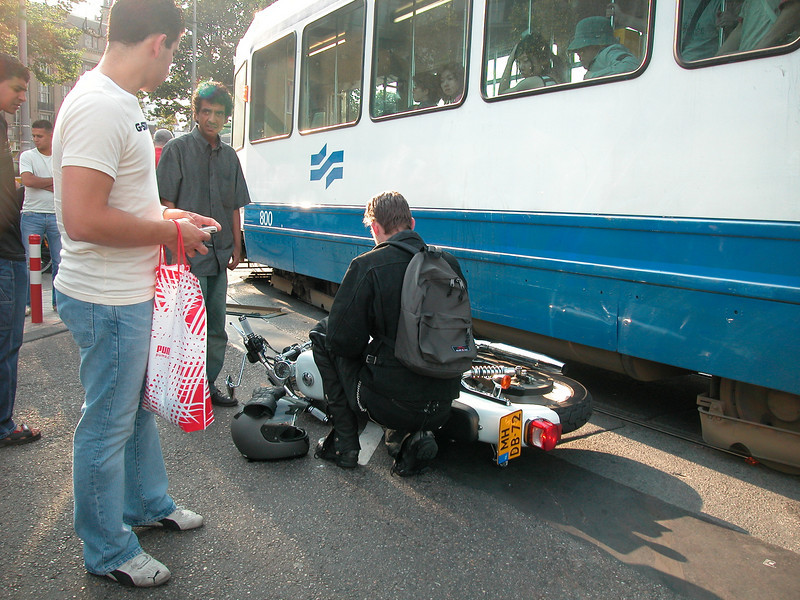 Oops, trams can not go left or right: they just have to follow the rail. This biker was confronted with this 'feature'...