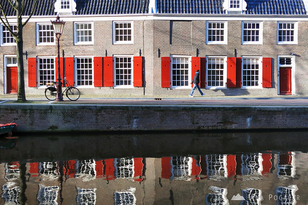 Old Church in Amsterdam reflected in a canal