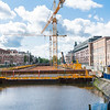 Cranes on platform over canal building and under-canal carpark