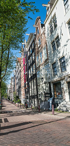 Traditional Dutch apartment buildings on Amsterdam street.