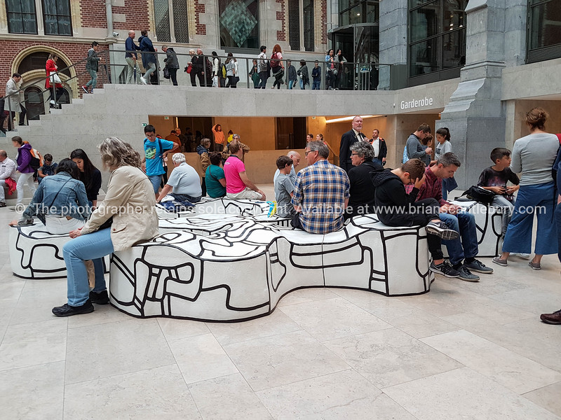 White and black freeform art piece being used by visitors to Rijks Museum in the gallery's foyer.  Model or property release; NO, for personal or editorial use only please.
