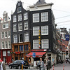300-400 year old buildings tend to settle in the wet ground in Amsterdam.