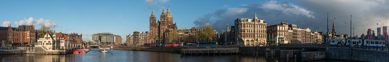 "Panoramic view of Amsterdam city across the Amstel river which runs through the city of Amsterdam. The river's name is derived from Aeme-stelle, old Dutch for ""water-area"", namely, an area abounding with water. Amsterdam, the Netherlands, Europe."