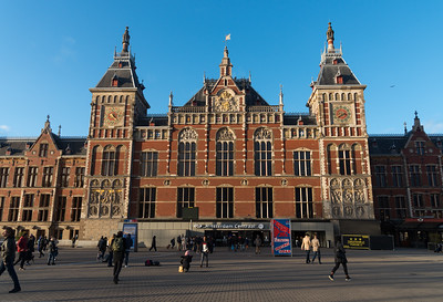 Amsterdam Centraal was designed by Pierre Cuypers, who is also known for his design of the Rijksmuseum in Amsterdam. While Cuypers was the principal architect, it is believed that he focused mostly on the decoration of the station building and left the structural design to railway engineers. Amsterdam, the Netherlands, Europe.