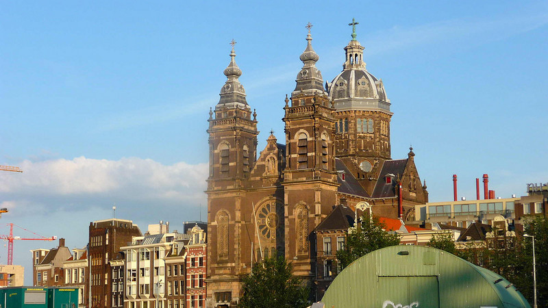 For many visitors to Amsterdam this is one of the first buildings they see on emerging from Centraal Station. The massive gothic-style Church of St Nicolas was built during the Catholic Emancipation in the 19th Century.Like many Amsterdam church buildings it is built into the line of street buildings rather than being set apart