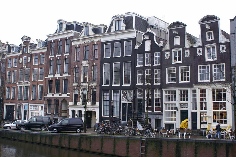 Typical old Amsterdam buildings - very tall and narrow. Note the lifting beams projecting from the front top of each building to enable furniture, etc to be lifted in and out through the windows. The Dutch gave a different meaning to the phrase 'steep staircase'