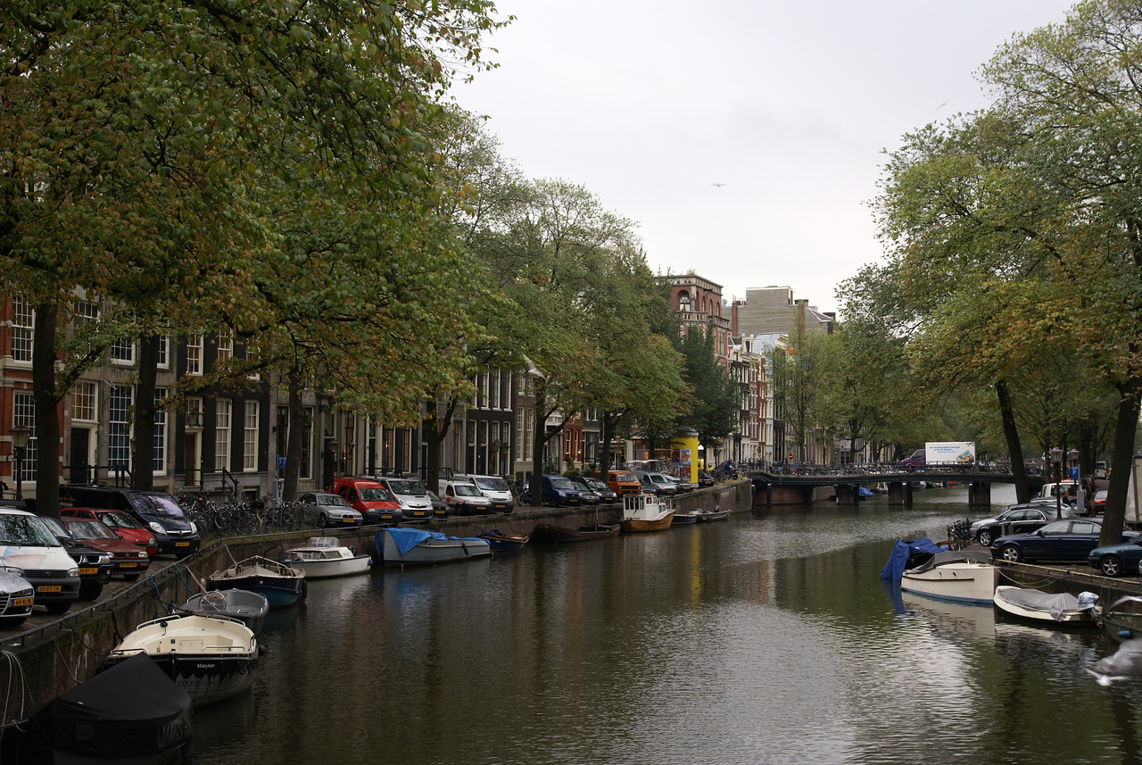 Typical canal with buildings and narrow road along each side of canal.