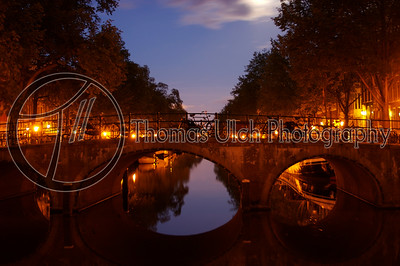 """I really like the upper and lower """"v"""" made by the sky and it's reflection in the water. Amsterdam, Netherlands."""