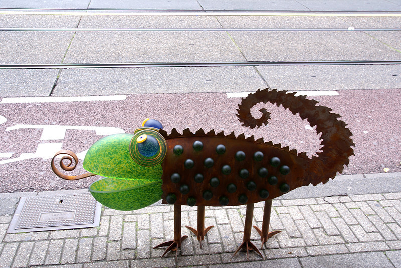 Whimsical creature on sidewalk