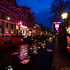 I was struck by the juxtaposition of pure white swans floating along the canal in De Wallens (Red Light area) with the pink neon changing their natural colour