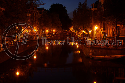 The canals just before dawn. I love walking though what is normally a very chaotic environment and being completely alone. It pays to get up at 4 am! Amsterdam, Netherlands.
