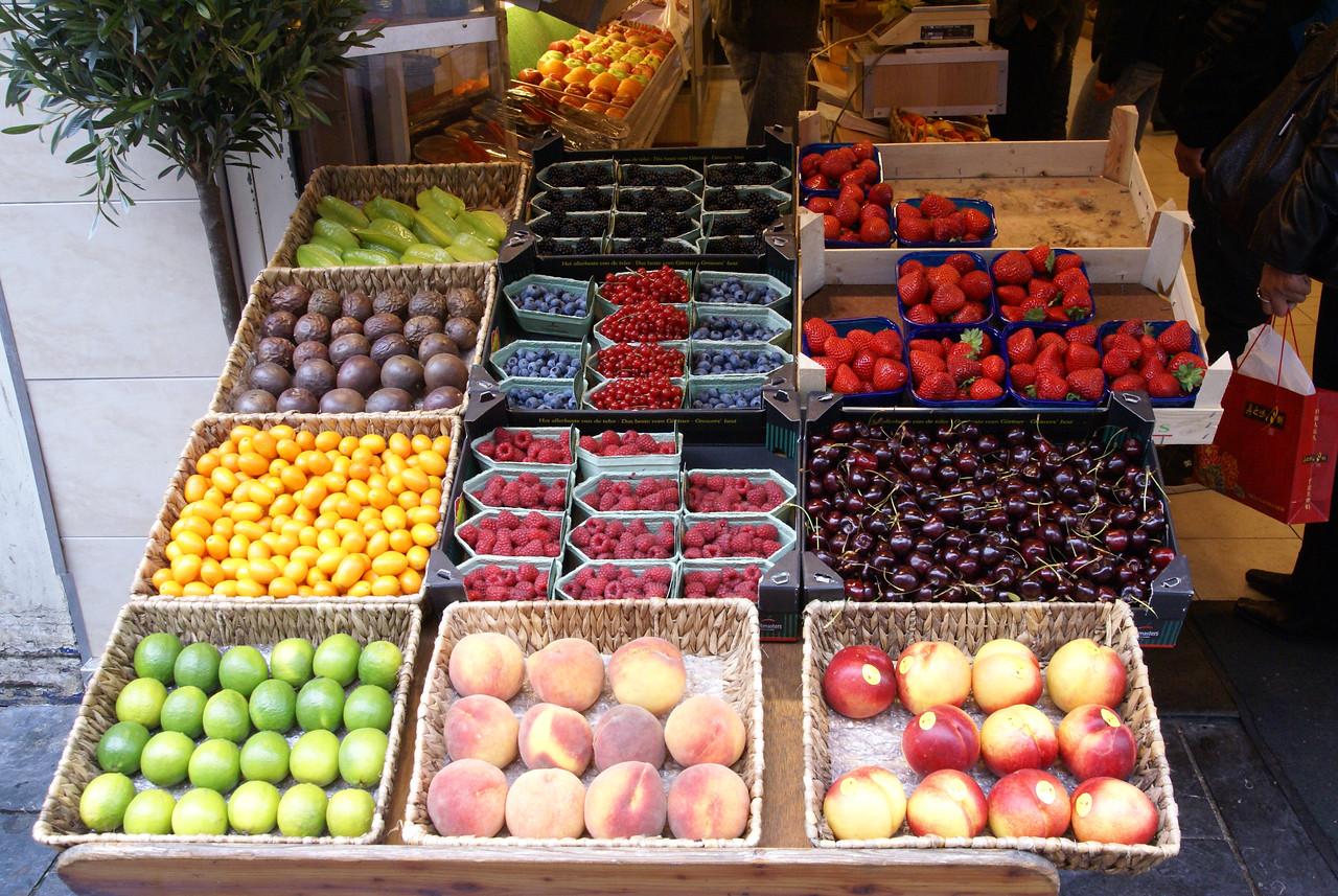 Fruit on sidewalk in fron of market.