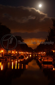 A full moon over the canals. Amsterdam, Netherlands.