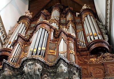 Oude Kerk - the Great Organ, added in 1724.  Christian Vater's oak encased organ has eight bellows and 54 gilded pipes.  Marbled-wood statues of biblical fifures surround it.