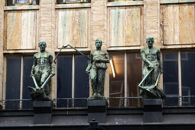 Statues on front of building.