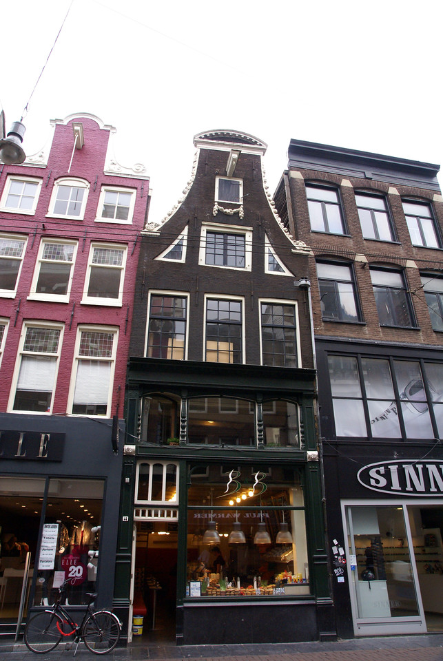Narrow houses/buildings on canal street.
