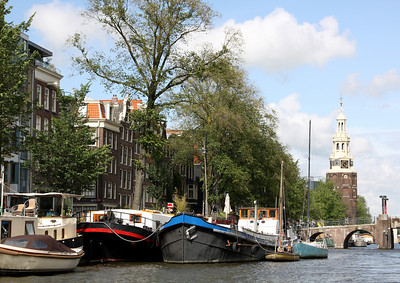 Boats and canal, with the medieval Montelbaanstoren tower, Amsterdam.
