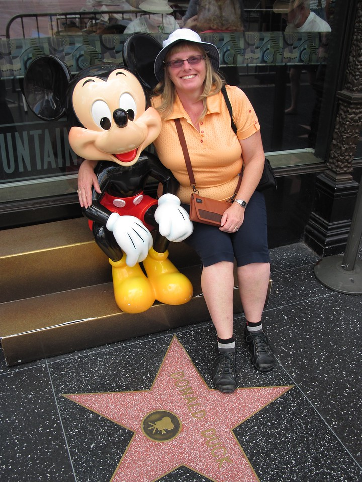 Mickey stepping on Donald's Star