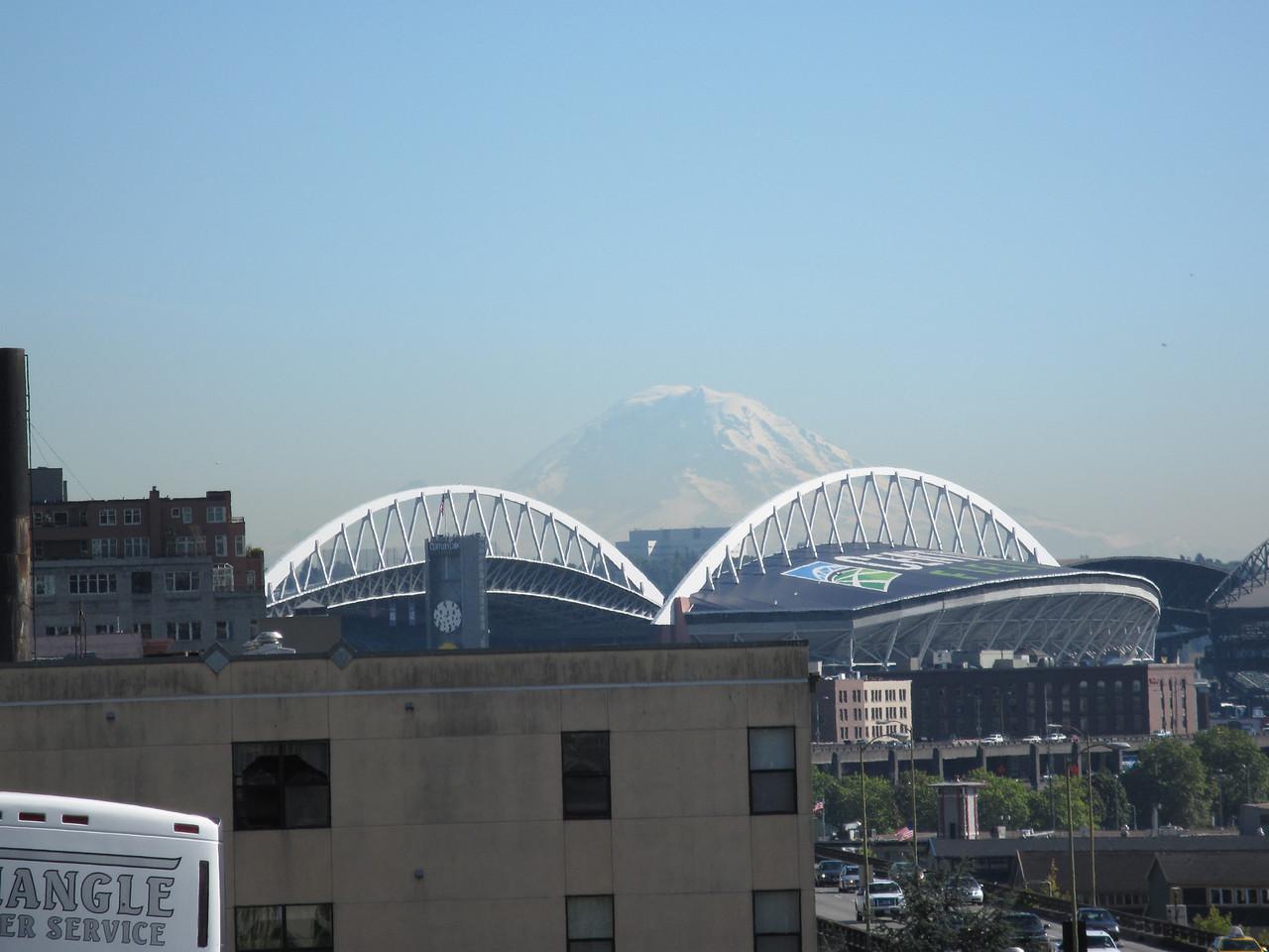 Mount Rainier over the Seattle football Stadium