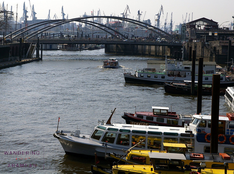 Boats, bridges and cranes on the Hamburg harbor