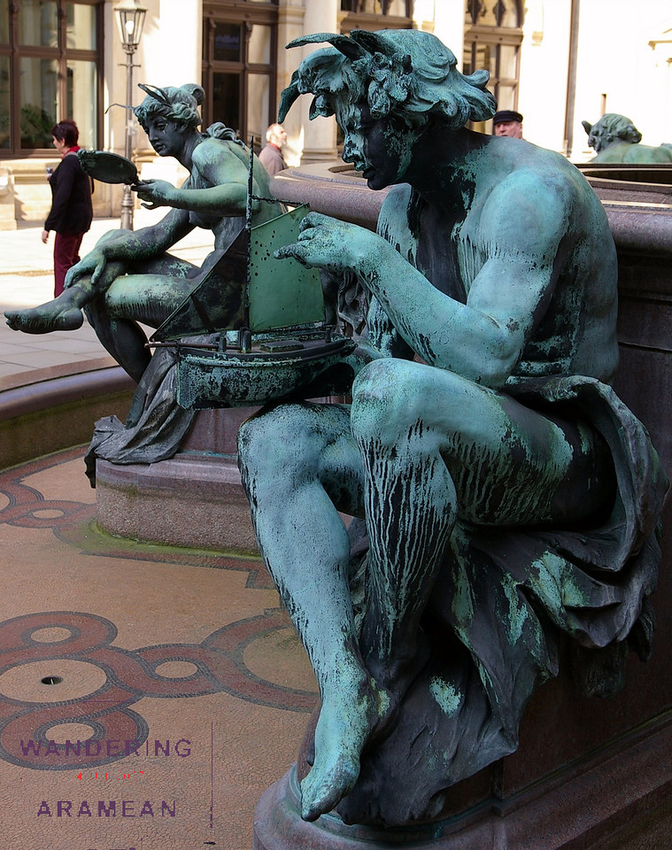 Statues honoring the sea in the Rathaus courtyard