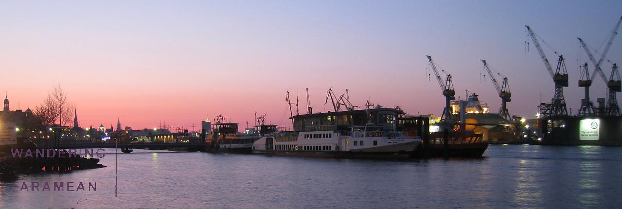 Sunrise on the Elbe and Hamburg harbor
