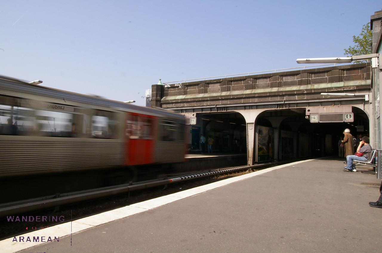 An S-Bahn train pulling out of the Landungsbrücken station in Hamburg