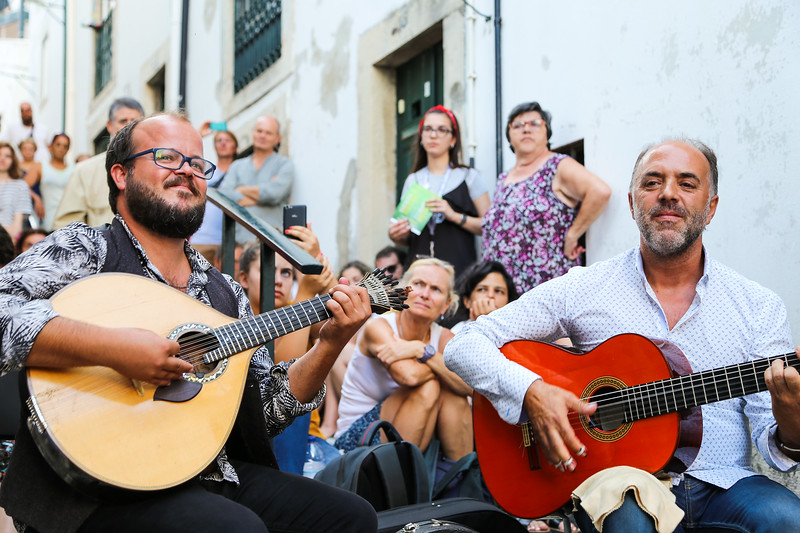 Fado musicians play a concert in the streets of Alfama, Portugal