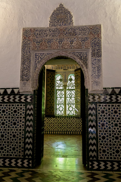 Peeking through a doorway in the Real Alcazar of Seville