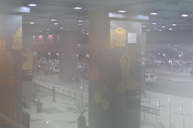New Delhi airport through a foggy lens.