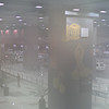 New Delhi airport through a foggy lens.