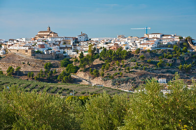 The mountain village of Baena overlooking hillsides of olive trees in Adalucia, Spain