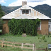 """Mora, NM.  """"Home for sale, if you can find the front door!"""""""