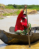 A woman paddler, Tonle Sap lake.