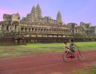 Angkor wat rear- two local boys on early sunrise ride, Cambodia