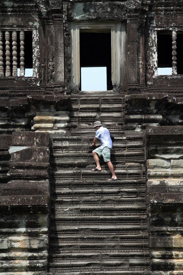Climbing Steep Stairs At Angkor Wat.