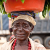 <strong><center>The Angolan women are strong and beautiful, and while we Norwegians carry what we need in a backpack, the Angolan women all use their head. It is an art of movement and strength.  This old lady with her beautiful smile was selling vegetables at a marked in the Kwanza Sul province in Angola.