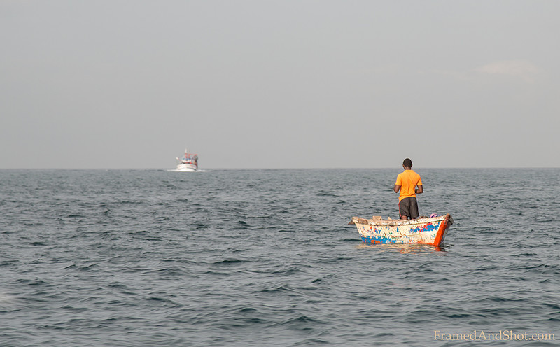 <strong><center>The Lonely Fisherman and the sea. </center></strong> A lot of angolans live of fishing. When going out on the ocean you often find them - almost in the middle of nowhere and in a little boat, fishing for food and income.