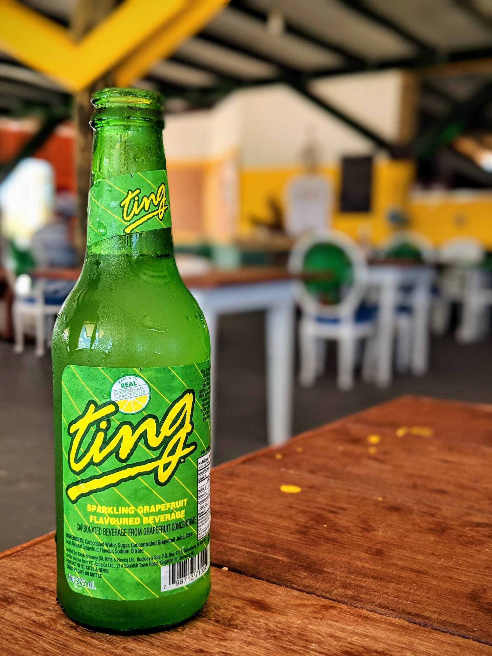 Ting grapefruit soda, a popular drink in Jamaica, on a table in a restaurant.