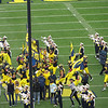 Michigan football tradition--the team runs on to the field and leaps up to touch the M Go Blue banner.