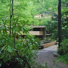 First view of Fallingwater from the driveway.  Notice the bridge over the Bear Run Stream.