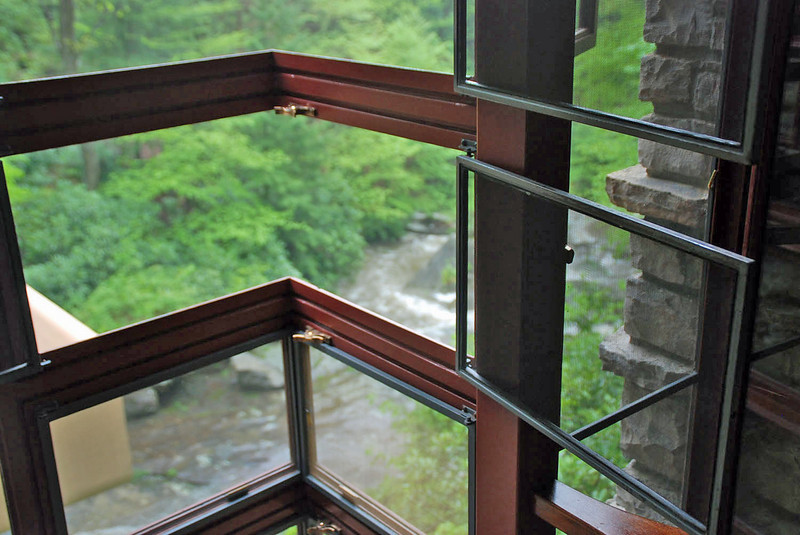 Detail of the corner windows with both screen and glass open.