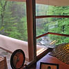 The cornerless windows in the master bedroom (Tiffany lamp on the desk).