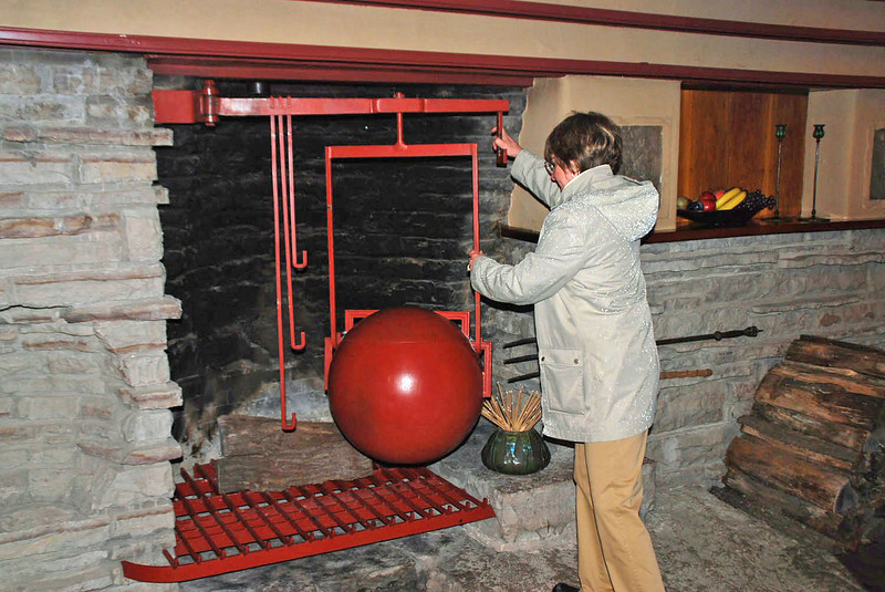 The large sphere rotates over the flames of the fireplace to make mulled wine.