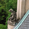 A gargoyle bear with honey pot.
