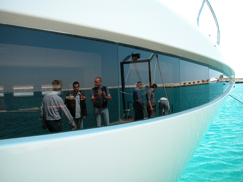 Project 144: M/Y Phoenix, I'm seeying the people standing behind me, via the reflection in the window...